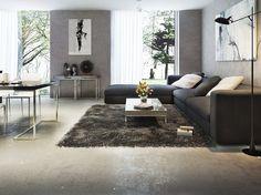 canapé d'angle gris anthracite, tapis shaggy assorti, table basse design et revêtement de sol assorti