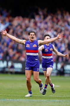 Tom Boyd of the Bulldogs celebrates a goal during the 2016 AFL Grand Final match between the Sydney Swans and the Western Bulldogs at Melbourne. Melbourne, Sydney, Western Bulldogs, Male Athletes, Pro Cycling, Great Team, Athletic Men, World Of Sports, Swans