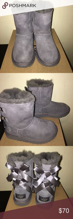 UGG GIRL BAILEY BOW BOOTS BRAND NEW IN BOX SZ12 UGG GIRL BAILEY BOW BOOTS BRAND NEW IN BOX SZ12 please ask questions or look at pics thanks THEY ARE BRAND NEW AND THEY DINT HAVE THE WRAPPING PAPER OR THE UGG INFO BESIDES HE INE IN THE PICTURE . EVERYTHING I SELL IS AUHENTIC/ ORIGINAL PLEASE READ MY REVIEWS THANKS . Not going lower than 70 sorry UGG Shoes Rain & Snow Boots
