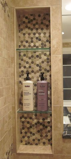 Shower niche - easy to add between studs! I like the glass shelves, you could remove them to clean...most get lots of soap scum and are so hard to clean...hmmm