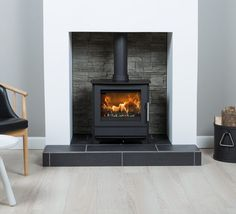 Envirostoves is a family run stove business based in the Somerset countryside. We are enthusiastic experts in all things stove and experienced suppliers to the whole of the UK. Wood Burner Fireplace, Home Fireplace, Fireplace Remodel, Modern Fireplace, Fireplace Surrounds, Fireplace Design, Fireplace Ideas, Modern Log Burners, Modern Wood Burning Stoves