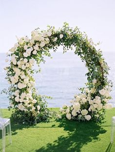 Giant wreath with lush florals for a seaside affair. #DIY #weddings #giantwreath