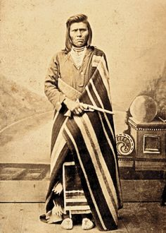 Defeated and temporarily deported from his native land, this undaunted and stern-visaged Nez Perce man poses in tribal costume and prominently holds a Colt Model 1860 Army, Richards-conversion revolver, in this circa 1880 carte de visite by H Beck of Winfield, Kansas.  – Courtesy Dickinson Research Center, National Cowboy & Western Heritage Museum, 2004.015.3 –