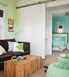 i like this idea for a studio room, bedroom with a barn door (love the galvanized metal the door sits on) and can have 2 different colors in compatible accents that allow these adjacent rooms to work in harmony)