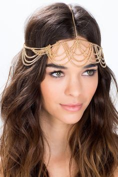 A supreme boho queen style head chain, featuring overlapping draped accents and a brilliant gold finish. Lightweight metal body. $10.50