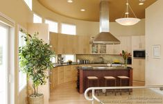 Idea of the Day: Modern Kitchen Designs. (By Crown Point Cabinetry). Elegant, two tone light wood dark cherry island hood curved Light Wood Cabinets, Light Wood Kitchens, Cool Kitchens, Modern Kitchens, Kitchen Design Gallery, Modern Kitchen Design, Kitchen Designs, Kitchen Ideas, Updated Kitchen