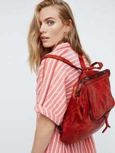 Loved Leather Messenger | So soft distressed leather backpack featuring adjustable/removable shoulder strap for versatile wear. Front zip pocket and zip top closure. Soft lining and multiple inner pockets.