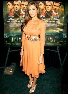 Eva Mendes chose an ultra-feminine orange long-sleeve Prada dress