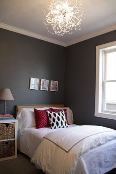 Sweet light fixture & love the wall color with the red accents
