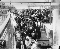 Migrants leave the boat at Ellis Island