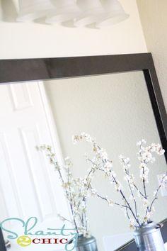 DIY frame for a builder grade plain bathroom mirror.
