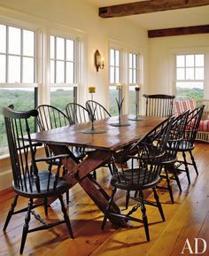 I love that there are so many windows. [country cottage rustic-dining-room]