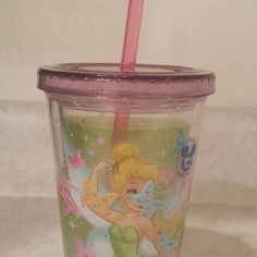 Disney store Tinkerbell cup with floating butterflies and glitter when you shake it. Like new $5