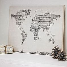 Sheet Music World Map Art Print - maybe make by modpodging music sheets/ newspaper on, then covering with map cutouts and painting?