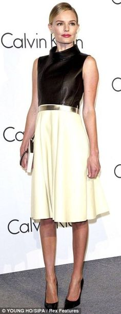 KATE BOSWORTH. The actrees and modelshowed her fashion prowess in a leather halterneck top and eggshell swing skirt, topped off with a shiny silver belt. She attendeda one-night exhibition thrown by Calvin Klein in Seoul.  (Kate Bosworth at Calvin Klein party | Mail Online)