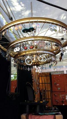 Bicycle wheel rim used as tiered jewelry display/chandelier Bicycle Rims, Bicycle Wheel, Bicycle Art, Bicycle Crafts, Bike Craft, Craft Show Displays, Store Displays, Jewellery Storage, Jewellery Display