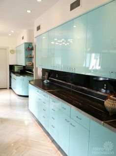 """Beautifully refurbished vintage metal kitchen cabinets, repainted with PPG auto paint. The flooring is Armstrong's Striations line in the """"atmosphere"""" color. 