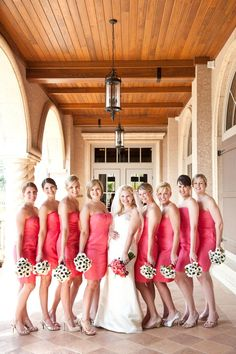 Love these Watermelon colored dresses bridesmaid dresses paired with black and white anenome bouquets