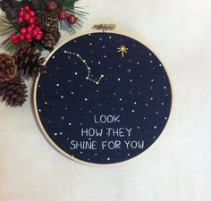"""""""LOOK HOW THEY SHINE FOR YOU"""" Hand Stitched Big Dipper & North Star Polaris Constellation Embroidery Hoop Art in starry night. This embroidery hoop art features Graceful Stories' original art with quote """"LOOK HOW THEY SHINE FOR YOU"""" to encourage everyone. This is Hand embroidered just for you, your family & friends! A lovely addition to your child's room or unique home decor; this hoop can be hung on the wall, propped against a shelf or on your desk. CLOSER LOOK This listing ..."""
