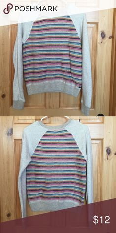 Roxy sweater Adorable sweater from Roxy. The front is like a sweater and the sleeves are sweatshirt material. Size is medium but it fits more like a small. Super cute! Roxy Sweaters