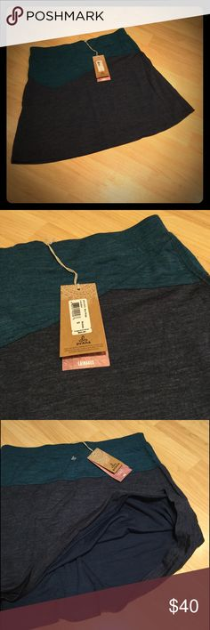 NWT Prana Livia Skirt Beautiful, extremely comfortable, lightweight skirt.  Can handle cool weather thanks to its wool blend nature.  70% Acrylic, 30% Wool.  NWT. Color: Blue ridge (teal and navy) Prana Skirts