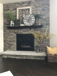 My fireplace..Metal Frame, Home sign, & clock (Hobby Lobby). Candle sticks at TJ Maxx