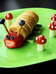 ritz n peanut butter crackers, cuke slices for legs, strawberry head and blueberry eyes, pretzel sticks antennae with blueberries and cheese sticks with half a cherry tomato for toadstools with ranch dip dots.  Too cute and easy!
