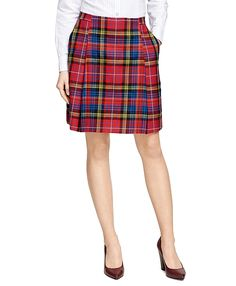 """<a href=""""#pdplearnmore"""" class=""""lm"""">The Red Fleece Collection</a><br>The classic wool box pleat skirt in tartan plaid is an essential for fall dressing. Featuring front slant pockets and a side seam zip closure. 20½"""". Dry clean. Imported."""