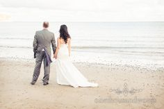 Bride and groom on Swanage Beach at Corfe Castle Wedding. Photography by one thousand words wedding photographers