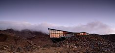 Knoll Ridge Cafe | Project Porfolio | HB Architecture, Whangarei New Zealand Mountains, Glass Curtain Wall, Cafe Seating, New Zealand Houses, Volcanic Rock, Glass Facades, Active Volcano, Concrete Floors, Geology