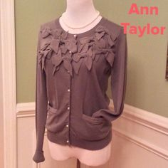 Ann Taylor Bow Sweater Darling Bow Lightweight Sweater in a soft gray color. Great loved condition!!!  2 front pockets and pearl like buttons. Super cute!!!  Price is firm. Ann Taylor Sweaters