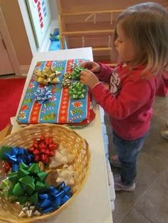 """Magnetic bows and cookie sheets: To make this activity, all you need to do is glue a small magnet onto the back of several Christmas bows. For the """"gift boxes, wrap metal cookie sheets with wrapping paper. Christmas Bows, Christmas In July, Christmas Themes, Kids Christmas, Holiday Crafts, Xmas, Christmas Christmas, Preschool Christmas, Preschool Activities"""