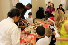 Clyde Simms and Darrius Barnes are so sweet! Helping decorate a gingerbread house at The Home for Little Wanderers' annual gingerbread decorating competition on Dec 4.