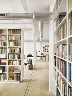 Super minimalist loft in Philly, but so warm and welcoming with all those books!