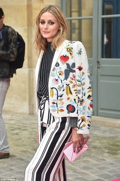 Pattern clash: She plumped for two types of stripes with a woodland theme jacket...