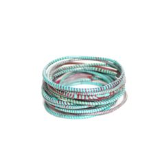 Flip Flop Bracelets - Turquoise | Hadja, who belongs to the Bozo tribe, lives with her eight children in Mopti, Mali. The Bozo tribe lives primarily from fishing in the river Niger. As a necessary addition to her income Hadja makes these colourfull bracelets out of old flip flops, the daily shoes of most of the population.