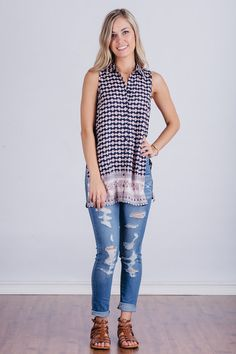 Beautiful sleeveless button up navy printed top with slits on the sides