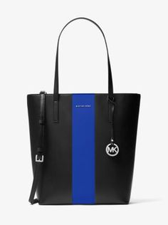 Designed in a spacious North-South silhouette, our Emry tote is an on-the-go essential, equipped to hold a laptop, umbrella and more. Polished leather with a contrasting center stripe and minimal hardware combine for a refined aesthetic, while dual carrying options lend added versatility.