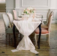 Soft, cascading linen with the mix of chairs is just the right amount of design to offset the simple decor on the table