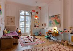 the first apartment, in the Boulogne-Billancourt district of Paris, looks like a Wes Anderson inspired dollhouse. the second apartment, in the 16th arrondissement, has a stuffed peacock in the lounge. it's fabulous.