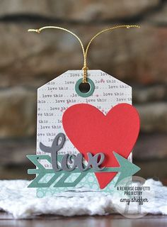 Tags by Amy Sheffer for Reverse Confetti. Confetti Cuts: Tag Me, Arrow, Heart to Heart and Pretty Panels Heart Love. Valentine's Day tags.