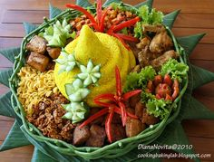 Nasi Tumpeng is a cone-shaped rice dish like mountain with its side dishes (vegetables and meat). Traditionally featured in the slamatan ceremony, the cone shape of rice is made by using cone-shaped weaved bamboo container. The rice itself could be plain steam rice, uduk rice (cooked with coconut milk), or yellow rice (uduk rice colored with turmeric).  In gratitude ceremony (syukuran or slametan), after the people pray, the top of tumpeng is cut and delivered to the most important person.