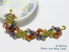 Rainbow Curve - XXOXX Bracelet - by BeeJang - Piratchada, via Flickr