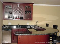 Basement Remodeling: Wet Bar.  I like the curve of the counter top.