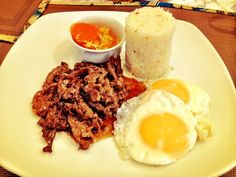 Beef tapa with egg (sunny side up) and garlic rice.