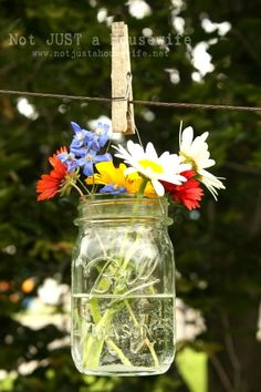Cut flowers in Mason jars.  Can't go wrong!