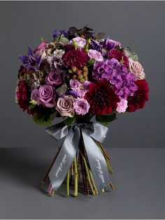 Wild At Heart - Autumnal Elegant Bouquet  - An elegant bouquet which combines fluffy purple hydrangea with lilac roses, blood red dahlias, purple clematis and blackberries. Picture showcases our large bouquet.