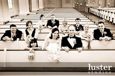 I did a similar photo with the Bride and Groom once. Love the whole wedding party. If the church lighting is good.