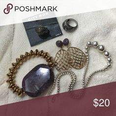 Costume jewelry bundle 2 silver toned cocktail rings (size 9). 1 pair pierced earrings with purple stone/gold plated metal, bracelet gold plated with matching purple stone, silver beaded necklace Various Jewelry