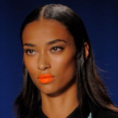Orange lips have been spotted at a few shows! Looks like this bright neon colour will be in for next spring! PERFECT! Gotta love orange lips :D